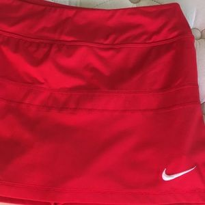 Mint red Nike Large tennis skirt with shorts.